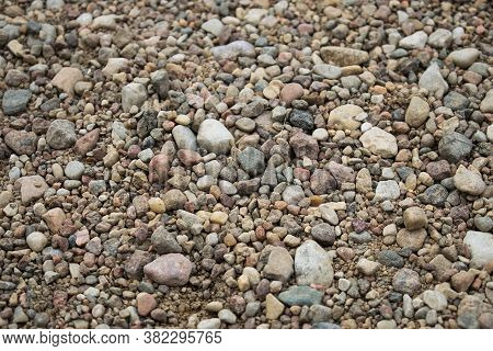 Background Which Consists Of Small Colored Stones In The Form Of Pebbles