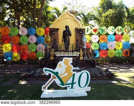 Bor Sang, Chiang Mai, Thailand, December 22, 2018: Image Of Buddha Between Umbrellas And The Logo Of