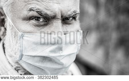 Portrait Old Man In A Surgical Bandage, Coronavirus, Medical Mask. Old Man Wearing Face Mask. Portra