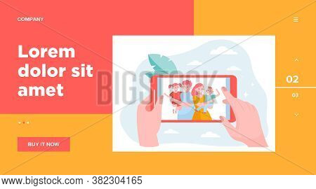 Hands Of Person Watching Family And Children Photo On Smart Phone. Picture Of Happy Parents And Kids