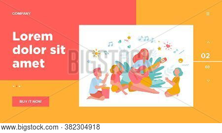 Group Of Kids Clapping Hands At Their Teacher Playing Guitar. Children Enjoying Music Class Outdoors