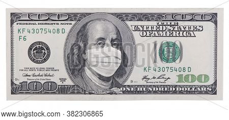 Close up of United States paper currency one hundred dollar bill with Benjamin Franklin wearing face mask. COVID-19 pandemic, great finance or economic crisis.