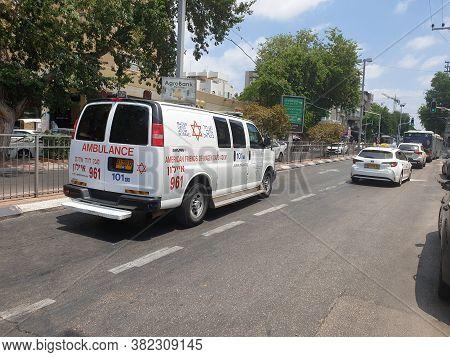 Holon, Israel. August 04, 2020. A White Magen David Adom (mada) Emergency Ambulance Minivan At Sokol