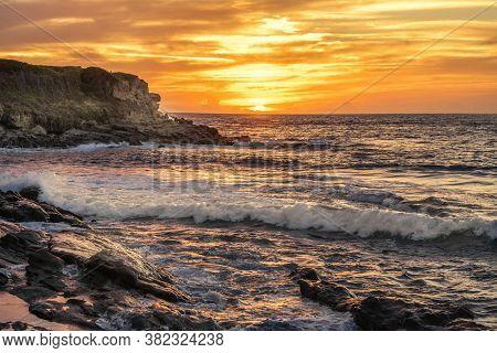Waves In Porto Ferro At Sunset. Sardinia, Italy