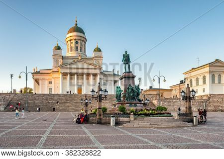 Helsinki, Finland - September 26, 2019: St. Nicholas Cathedral and monument of Alexander II on the Senate square Senaatintori in Helsinki, Finland.