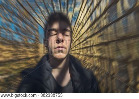 Portrait Of A Dreaming Young Man With Moving Background