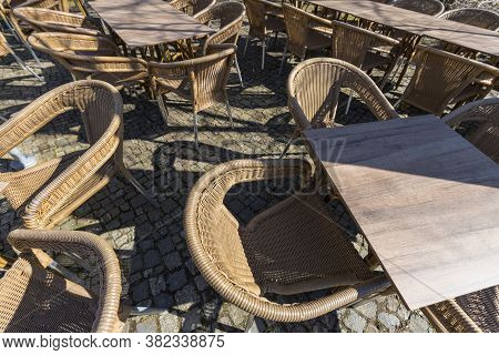 Empty Wicker Chairs Of A Cafe On The Terrace, Outside