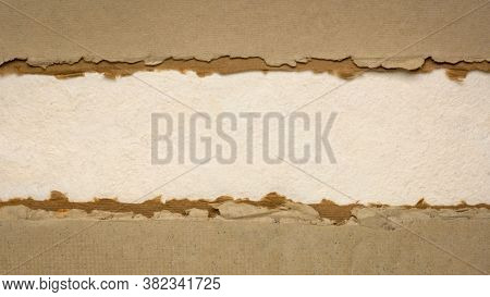 paper abstract in earth tones  with a copy space - sheets of bark and cotton rag paper, blank web banner