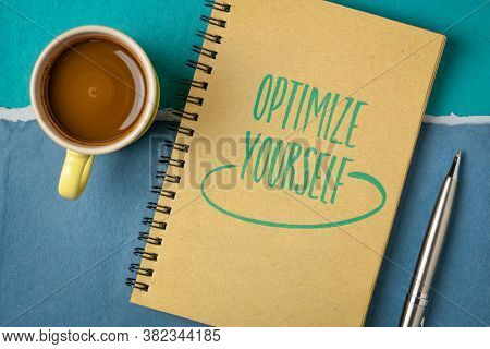 optimize yourself inspirational note - handwriting in a sketchbook with a cup of coffee, self improvement and personal development concept