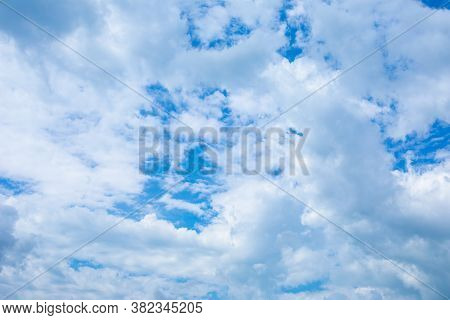 Summer Sunny Day Blue Sky With Large Piles Of White Clouds. Nature Background Backdrop For Design, N