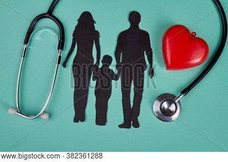 Family Clinic And Healtcare Concept. Silhouette Of Mother Father And Son Isolated On Turquoise Backg