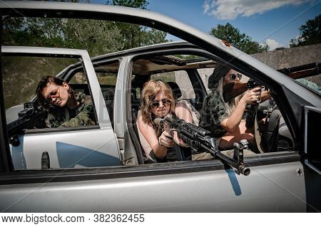 Team Of Female Soldiers Had Shooter Courses. Shooting From Car