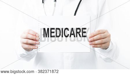 Doctor Holds A Sheet With The Word Medicare, Medical Concept