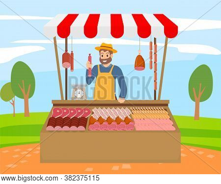 Local Market Farmer Selling Fresh Meat Produce On His Stall With Awning. The Farmer Sels At The Farm