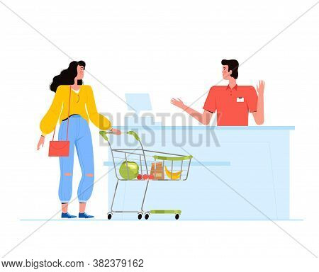 Young Woman With A Cart Of Groceries Stands At The Checkout In A Supermarket. The Cashier Communicat