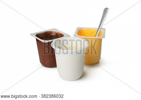 Plastic Cups Of Yogurt Isolated On White Background