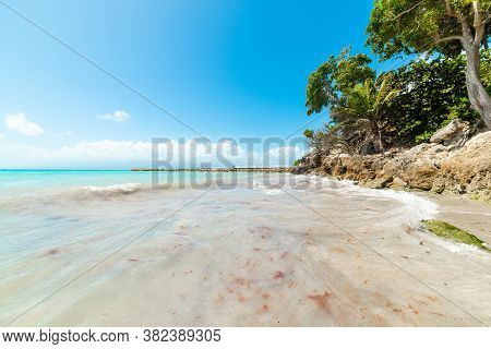 Bue Sky Over La Datcha Beach In Guadeloupe, French West Indies. Guadeloupe Is An Archipelago That Is