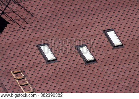 Asphalt Shingles Roofing Construction Texture. Area Asphalt Shingles Roof With Windows And Ladder