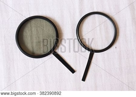 Two Magnifying Glasses With White Background. Black And White Magnifying Glass. Dark And Bright Side