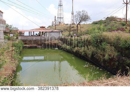 Polluted Water Reservoir Full Of Chemical Pollutants. Rain Water Harvesting In Rural Areas.