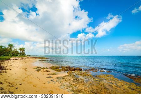 Clouds Over Autre Bord Beach In Le Moule, Guadeloupe. Guadeloupe Is A Archipelago Of French West Ind