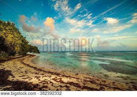 Sunset In Bois Jolan Beach In Guadeloupe, French West Indies. Guadeloupe Is An Archipelago That Is P