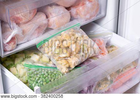 Frozen Cauliflower In Plastic Bag In A Freezer. Frozen Vegetables