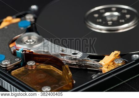 Disassembled Laptop Hard Disk Drive, Hdd. Close-up. Opened Hard Drive, Magnetic Heads And Disk Plate