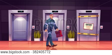 Technician Mechanic At Broken Elevator With Caution Sign On Lift Doors, Repair Or Maintenance Servic