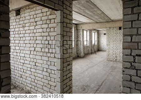 Unfinished Apartment In A White Sand-lime Brick Building. Concept: Object Of Unfinished Construction