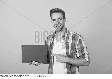 Marketing Goal. Happy Man Pointing At Pink Paper Sheet. Marketing And Advertising. Advertisement And