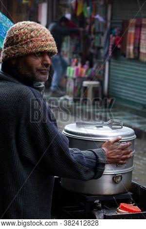 Mcleod Ganj, Himachal Pradesh - India - August 22 2020: Candid Shot Of A Momo Seller. Shot Taken In