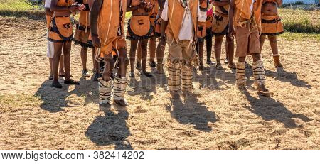 Group of Botswana traditional dancers, dancing in the sand in a village