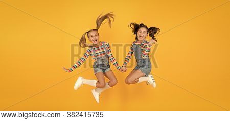 Party Fun Time. Little Girls Jump Yellow Wall. Sense Of Freedom. Finally Summer Vacation. Free And E