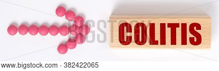 Medicine Concept. An Arrow Of Pills Points To A Sign That Says Colitis