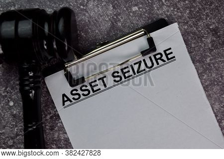 Asset Seizure Text Write On A Paperwork Isolated On Office Desk.