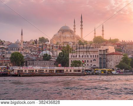 Istanbul, Turkey - May, 23, 2019: Sunset Shot Of The Ferry Terminal On The Waterfront And A Mosque I