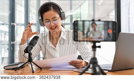 Asian Women Podcaster Podcasting And Recording Online Talk Show At Studio Using Headphones, Professi