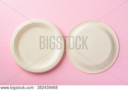 Front And Back Of Biodegradable Plate, Compostable Plate Or Eco Friendly Disposable Plate On Pink Ba