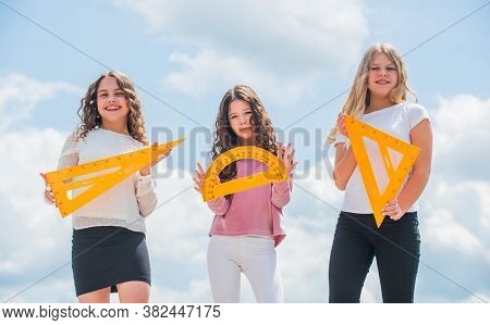Education Concept. School Students Learning Geometry. Girls With Triangle Ruler. Smart Friends. Scho