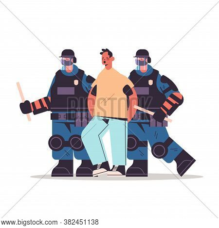 Policemen In Full Tactical Gear Riot Police Officers Arresting Male Street Protester During Clashes