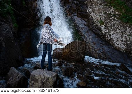 Young Happy Woman Enjoing The Summer Waterfall.