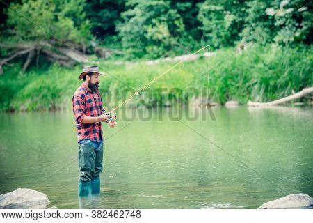 Nice Day For Fishing. Male Hobby Sport Activity. Successful Catch. Alone During The Fishing Process