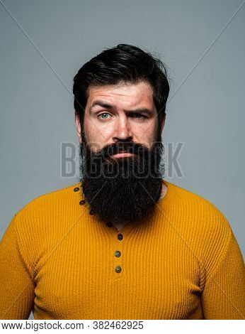 Serious Man Has Beard And Mustache, Looks Seriously