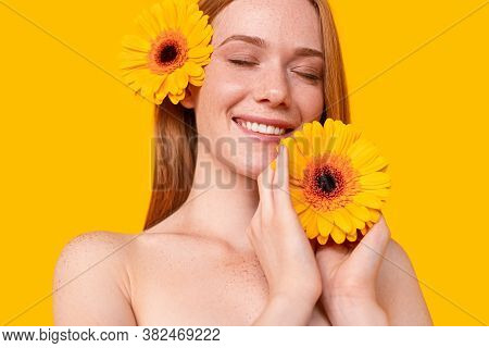 Optimistic Redhead Woman With Closed Eyes Smiling And Enjoying Softness Of Fresh Flower During Spa S