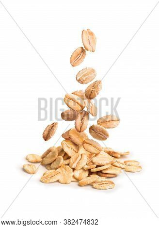 Oatmeal Falling On A Bunch Of Oatmeal On A White Background