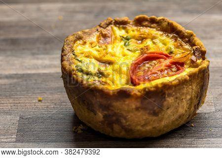 Little Gourmet Tomato And Egg Custard Tartlet Isolated On Brown Kitchen Work Top - Savoury Quiche Ba