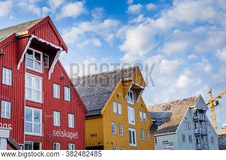 Old Wooden Warehousesalong The Harbor In The Center Of Tromso In Northerm Norway