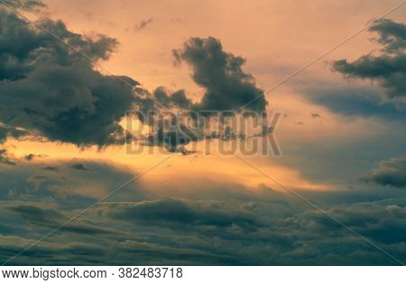 Sunset Sky With Gray And Golden Clouds. Gray Sky And Fluffy Clouds. Thunder And Storm Sky. Sad And M