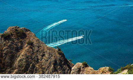 Seascape Panorama. Summer Vacation. Traveling. Virgin Nature. Yacht Trails On Ocean. Deep Blue Water